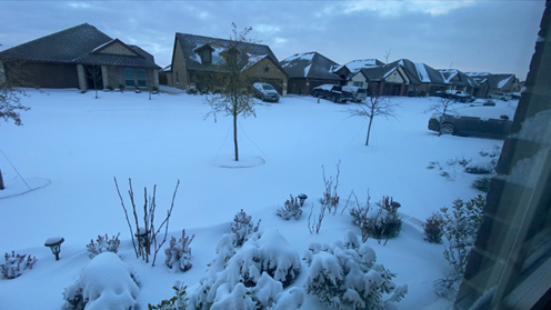 an image of a snow covered, suburban road