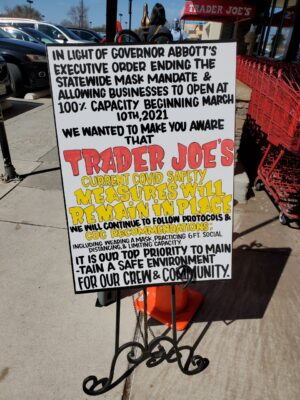 A sign at a Trader Joe's in Texas telling people that they will be upholding their mask policy in light of the lifted restrictions
